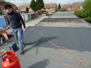 Applying a three layer felt system to a garage roof