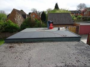 Completed 3 layer felt on a flat garage roof