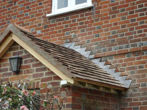 Listed building renovation of the porch roof and tiling
