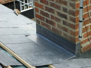 Back gutter to chimney hand crafted in lead