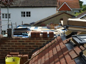 New roof tiles being installed