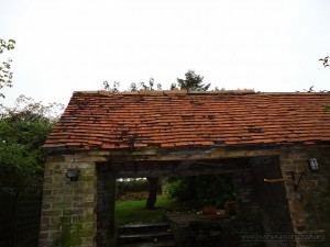 Outbuilding in need of renovation to the roof and gable end