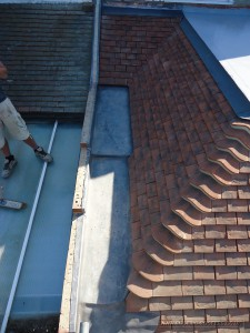 Hand crafted leadwork to weatherproof the roof gullies