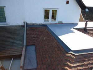 Sealoflex flat roof system to tiles