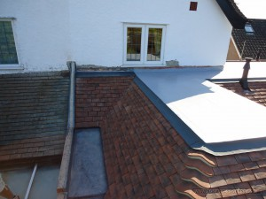 Flat roof system alternative to lead