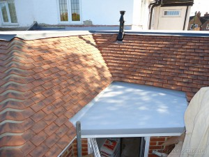 Tiled roof cut in to the porch flat roof