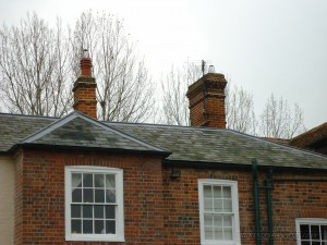 The completed natural slate roof renovation to this listed building