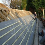 Breathable roof memberane being installed