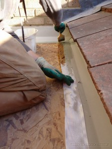 Applying the GRP resin to the edging tapes