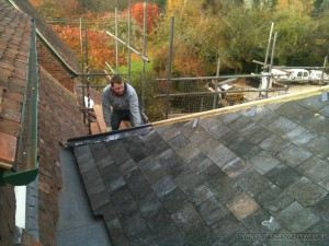 Creating and installing new leadwork to the roof hips
