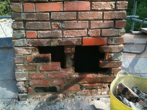 Image of this chimney shows the brickwork replacement and the mortar joints raked out ready to repoint