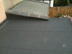 Flat roof felt replaced and ridge tiles re-fitted