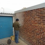 Raking out of brickwork joints prior to re-pointing