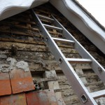 Stripping down the tiled fascia to expose the substrate