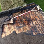 Exposed boards from the original roofing materials